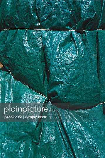 Green tarp packaging with string, Sweden.