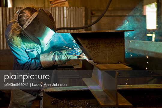 A man at work in a steel fabrication factory, Huntington, West Virginia.