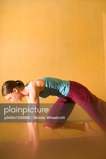 Woman doing yoga in a personalized studio