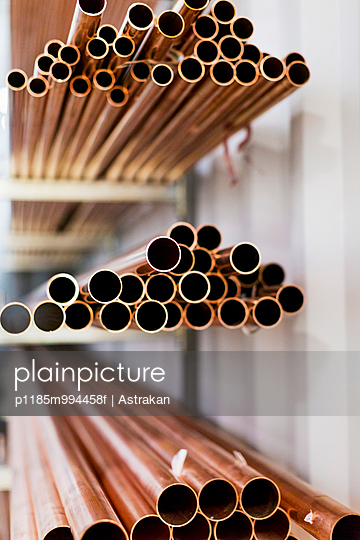 Heaps of pipes in factory