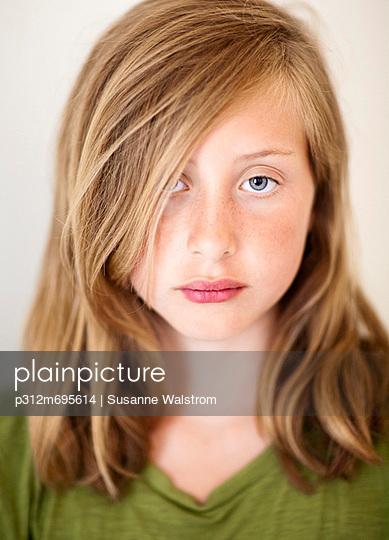 Portrait of serious girl, studio shot