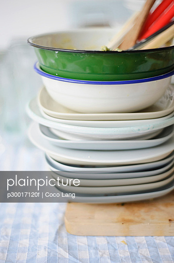 Stack of dirty dishes on table cloth