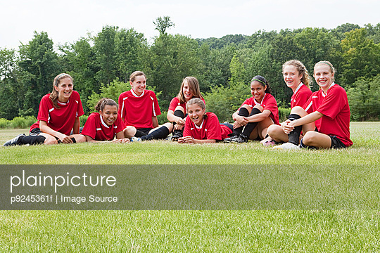 Girl soccer players on field