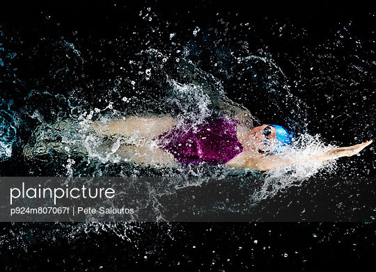 Young woman doing backstroke in swimming pool