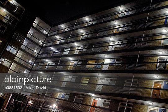 Block of council flats at night