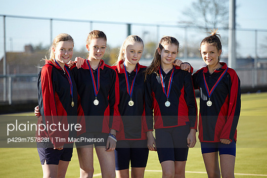 Sports team wearing medals
