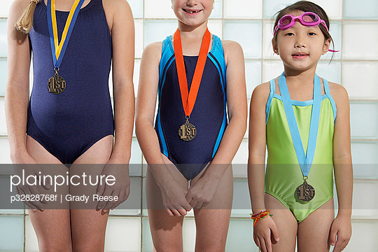 Swim team with medals