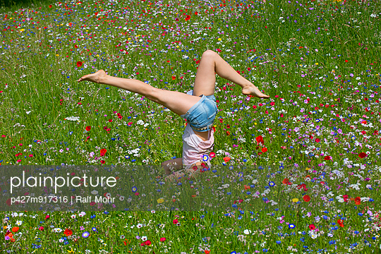 Young woman in a flower meadow I