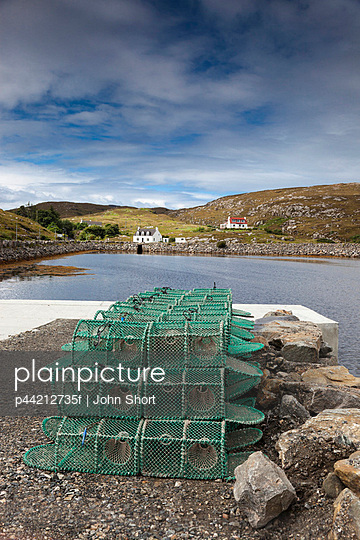 Fishing Traps Sitting On The Shore; Isle Of Barra, Scotland
