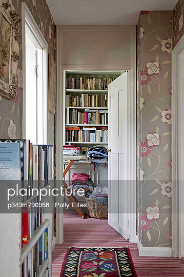 Floral patterned wallpaper in hallway of London home
