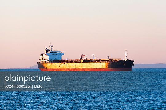 Oil tanker at sunset