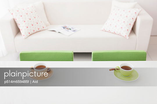 Two Tea Cups By Sofa