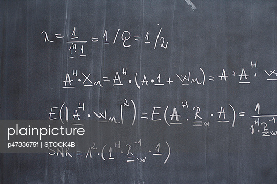 Blackboard with arithmetic\'s on it, close-up