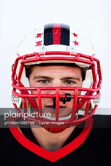 Studio portrait of football player (16-17)