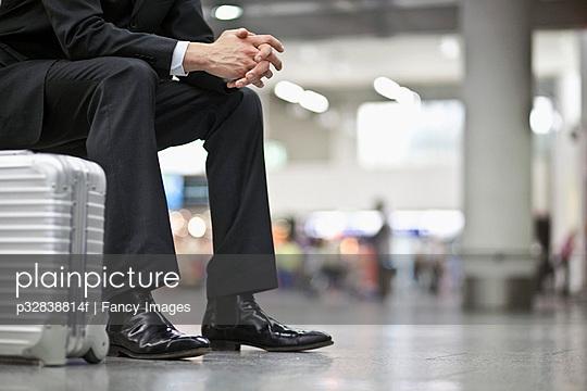 Businessman waiting in airport terminal