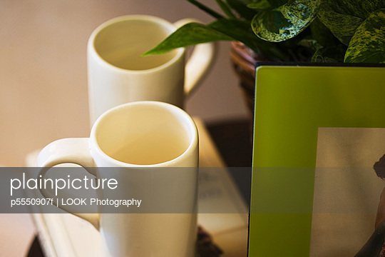 Contemporary White Mugs on End Table