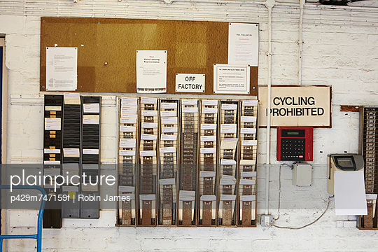 Time cards and clock in factory