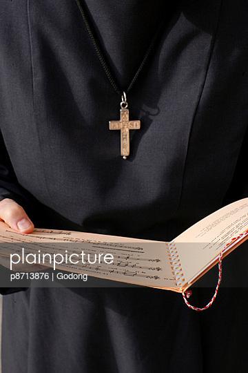 Catholic nun holding a music sheet, Annecy, Haute-Savoie, France, Europe