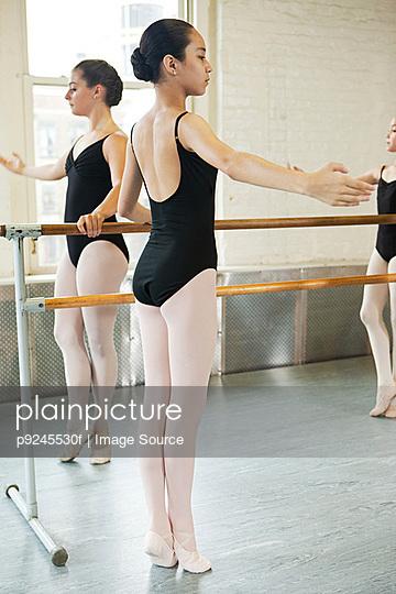 Ballerinas exercising at barre