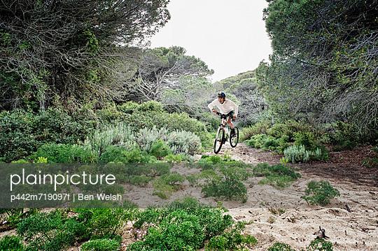Cycling over rugged terrain; tarifa, cadiz, andalusia, spain