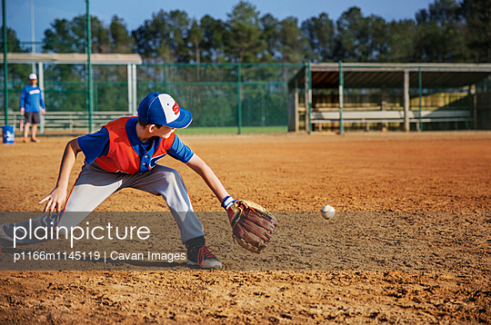 Boy playing baseball on field