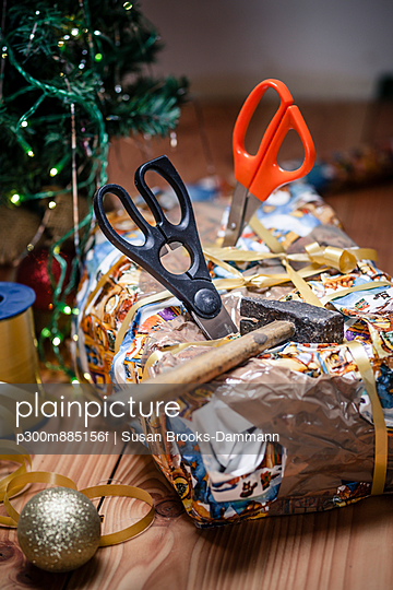 Bad packed Christmas gift spiked with scissors
