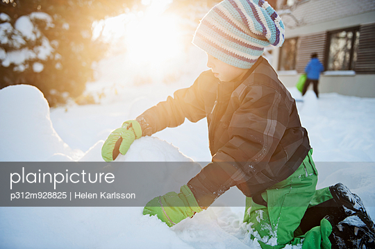 Boy playing at winter, Saltsjobaden, Nacka, Sweden