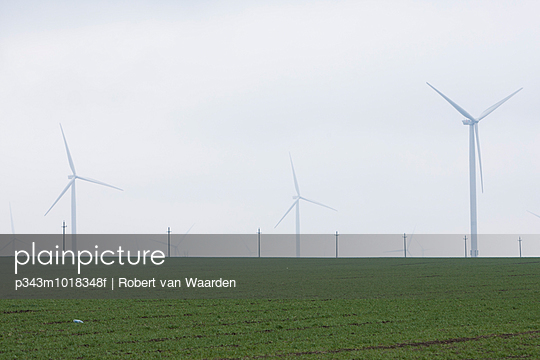 A green field and the wind turbines from Europe\'s largest wind farm, the Fântânele-Cogealac in the Constanta County in Romania.