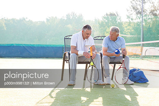 Two tennis players communicating