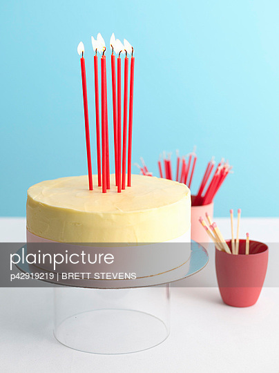 Decorated birthday cake with lit candles