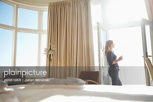 Woman in Hotel Room in Morning