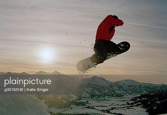 Snowboarder jumping in mid-air