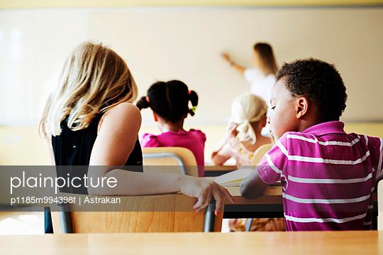 Teacher and children in class