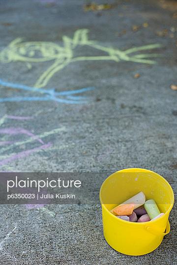 Chalk bucket on sidewalk