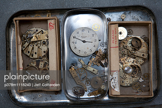 Watch dial and brass watch parts in three match boxes