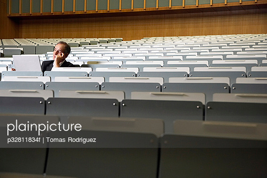 Older college student sitting in lecture hall