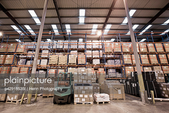 Stacks of pallets in warehouse