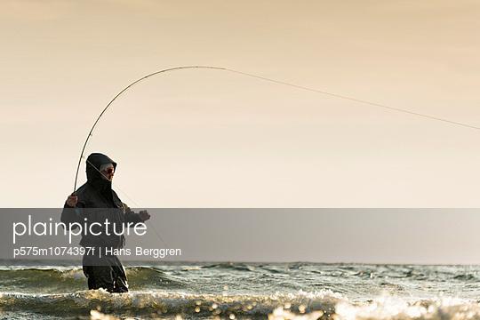 Man fishing at sea, Gotland, Sweden