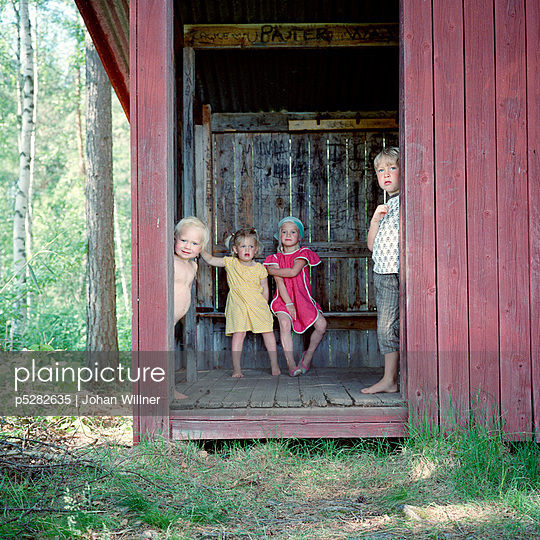 Children inside outhouse