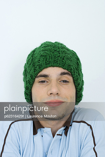Young man wearing knit hat