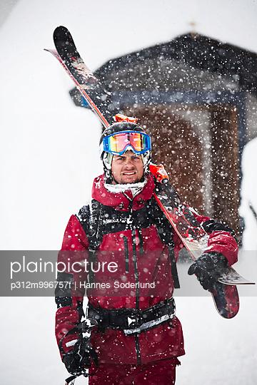 Man wearing ski clothes looking at camera