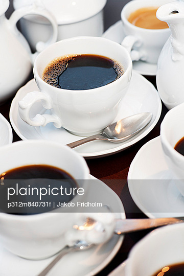 High angle view of coffees in cups