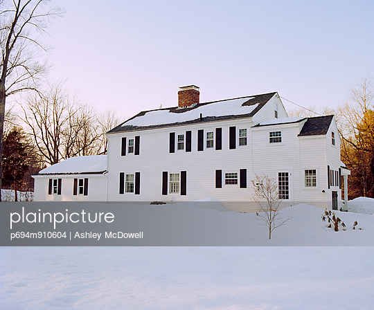 Colonial House in Snow at Sunset, Rear View