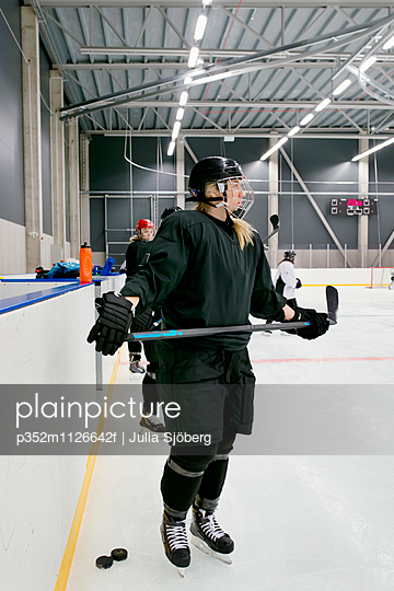 Sweden, Young ice hockey players by ice rink boarding