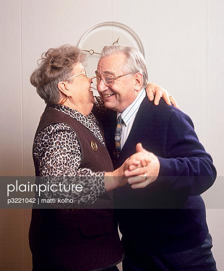 An elderly couple dancing