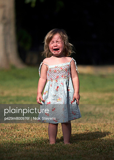 Girl crying in backyard