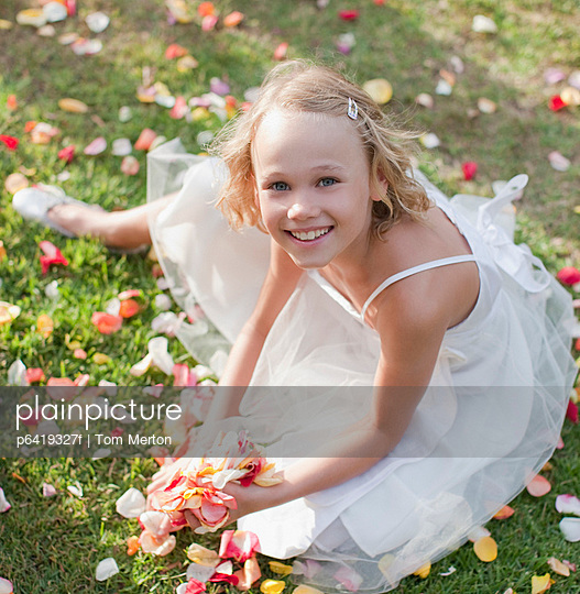 Flower girl holding rose petals