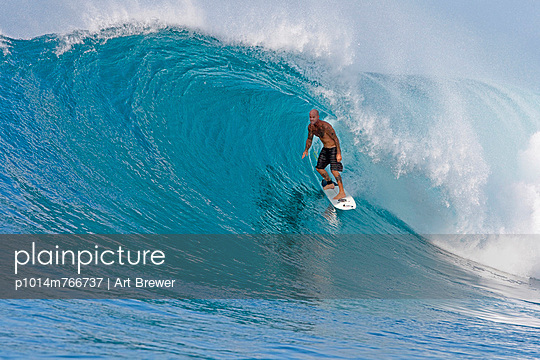 Matt Archbold surfing in the tube of a perfect beautiful wave in the Mentawais Islands