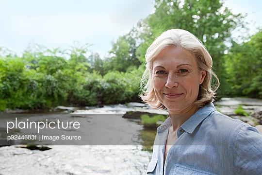 Mature woman in rural scene