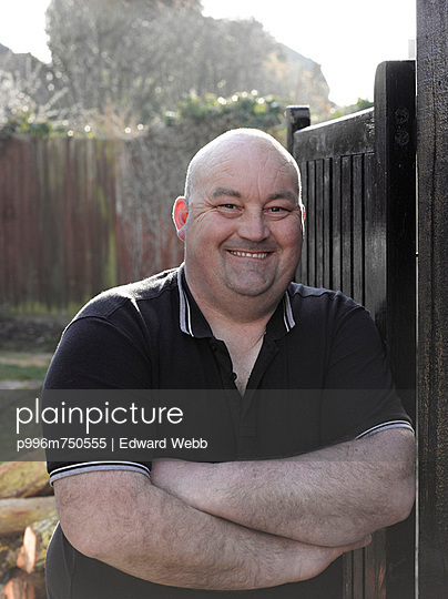 Happy Bald Middle Aged Man In Garden, London, England